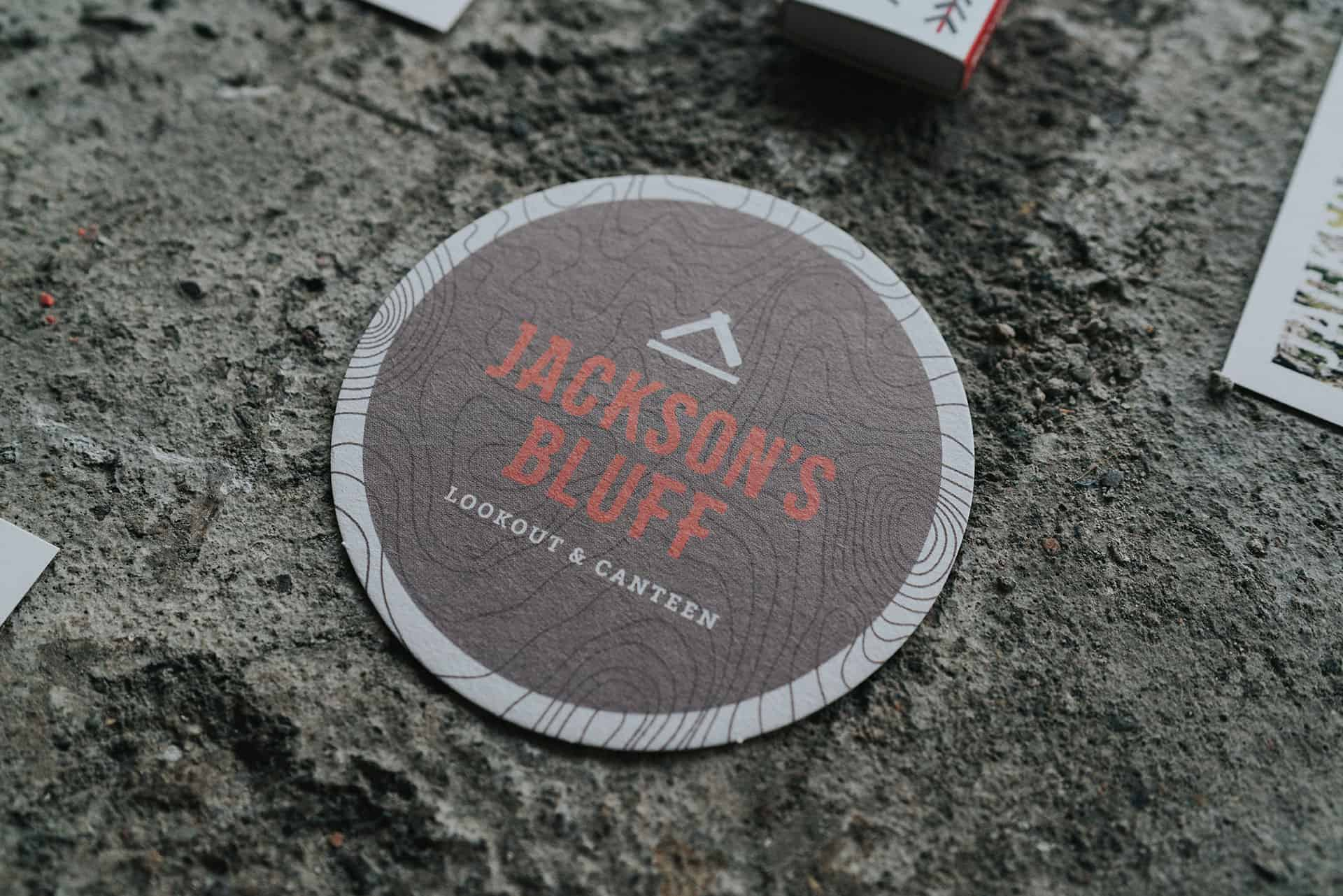 Jackson's Bluff lookout and canteen rooftop and bar branding for Crowne Plaza coasters