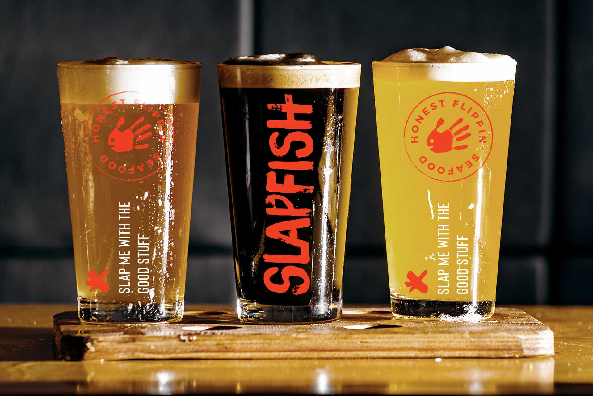 SlapFish seafood restaurant rebranding pint glass beer design