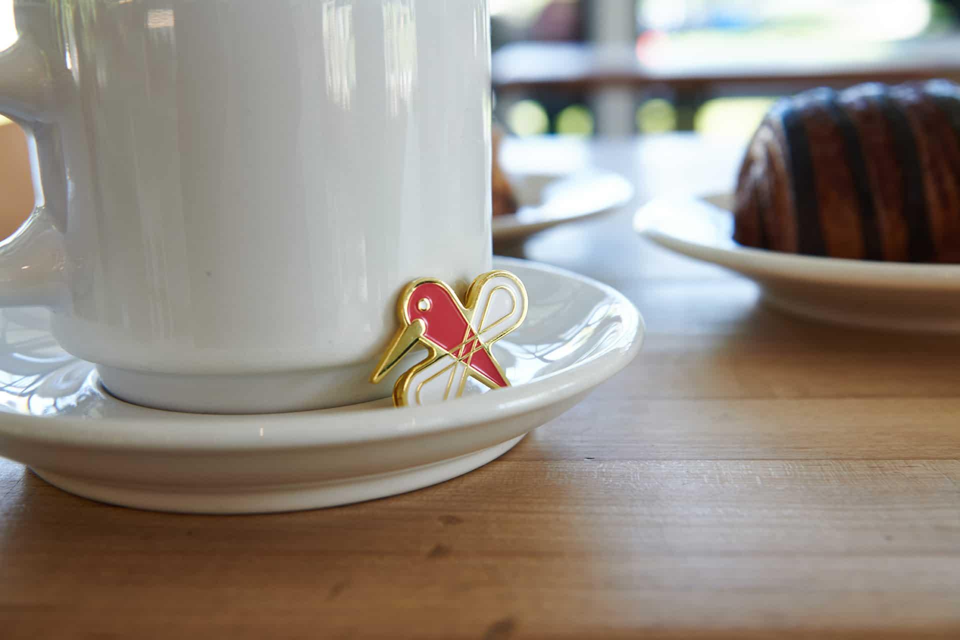 Zinnia bakery and cafe branding enamel pin