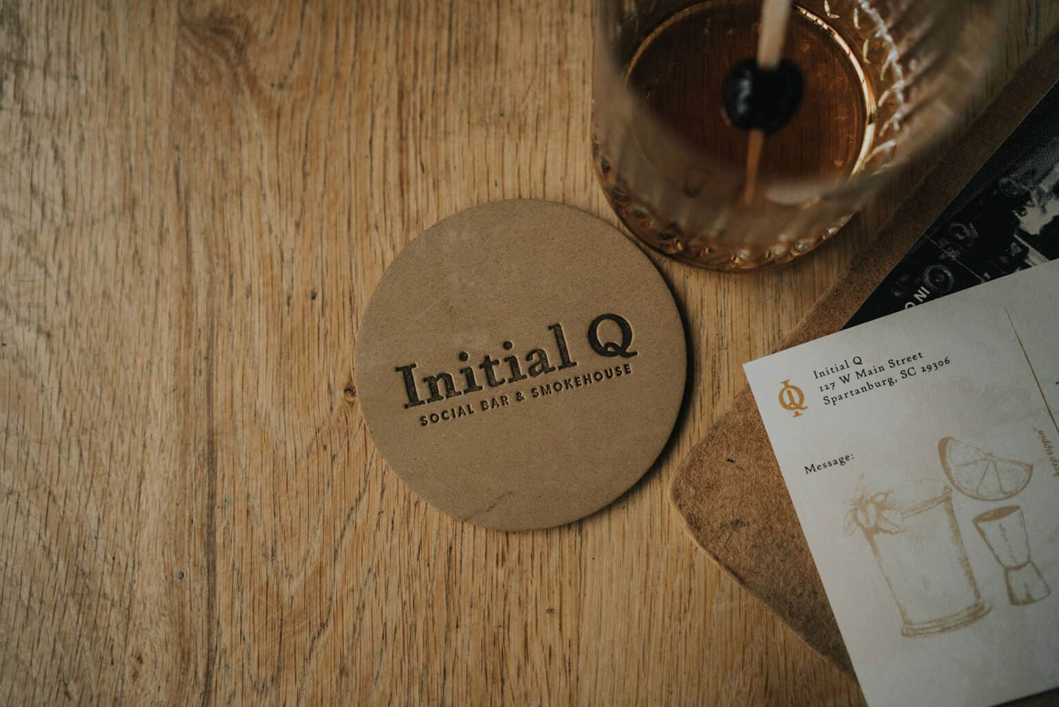 Initial Q barbecue full service restaurant branding & concept development